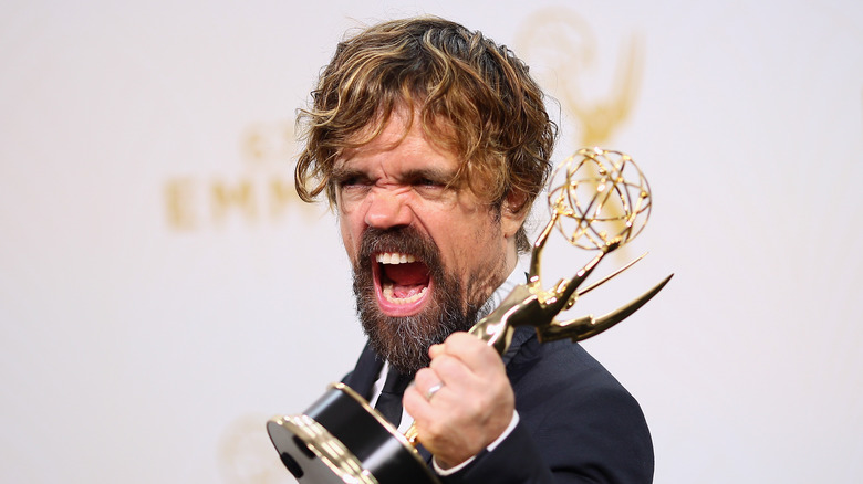 Peter Dinklage with an Emmy Award