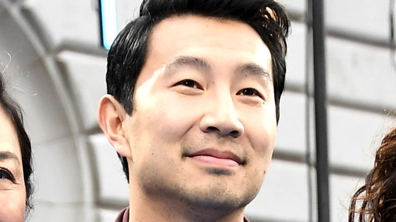 Simu Liu smiling