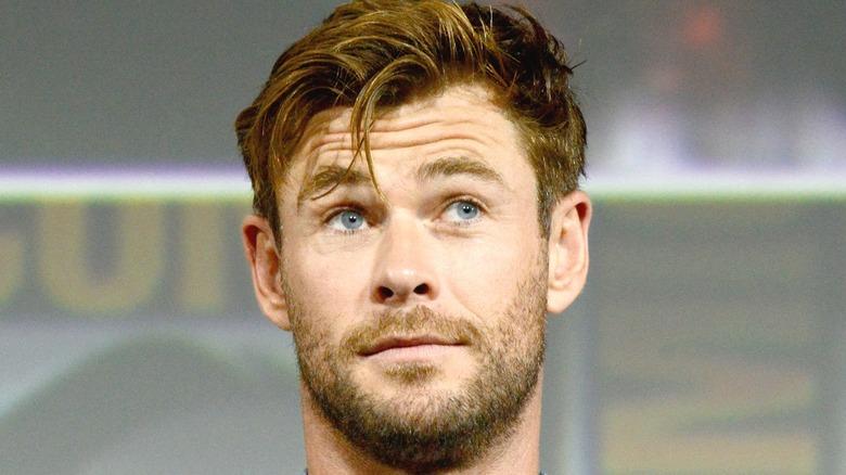 Chris Hemsworth looking up