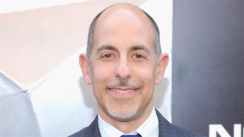 David S. Goyer smiling, wearing suit
