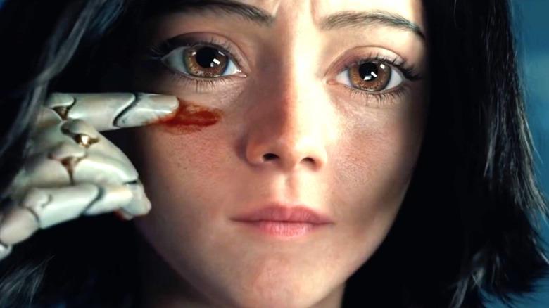 Alita in Alita: Battle Angel smearing something on her face