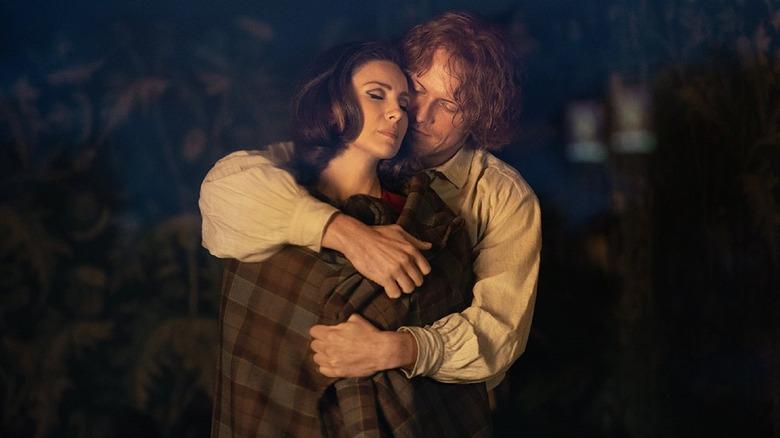 Jamie Fraser (Sam Heughan) holds Claire Randall (Caitriona Balfe) on Outlander