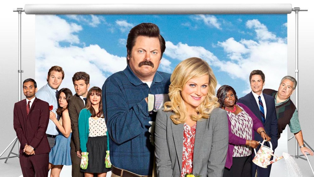 Leslie and Ron squeeze in to Parks and Rec cast photo