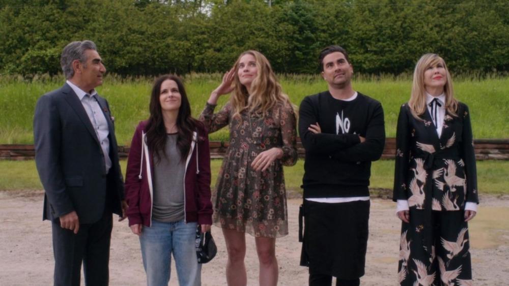 The Rose family admires their hotel on Schitt's Creek