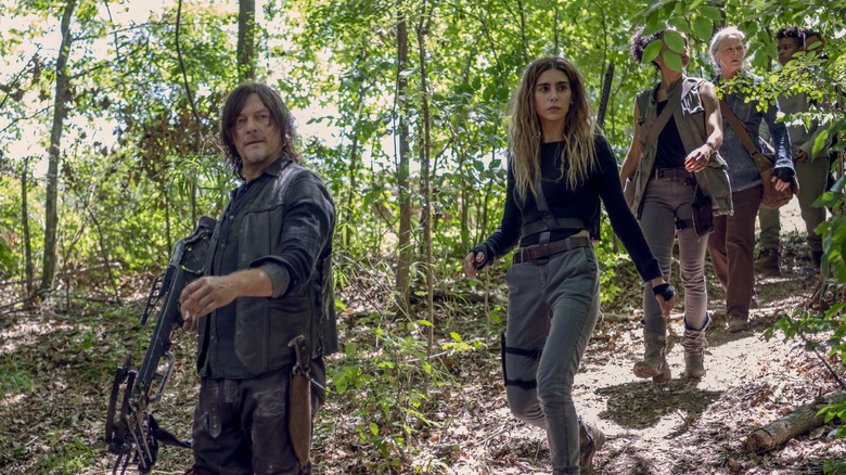 Daryl (Norman Reedus) leads a group through the woods on The Walking Dead
