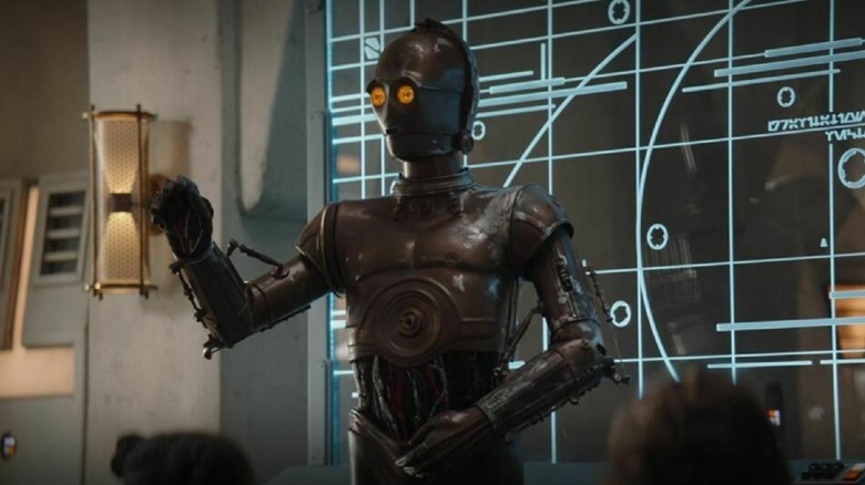 A protocol droid teaching students on The Mandalorian
