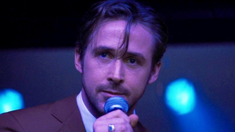 Seb Wilder speaking into a microphone