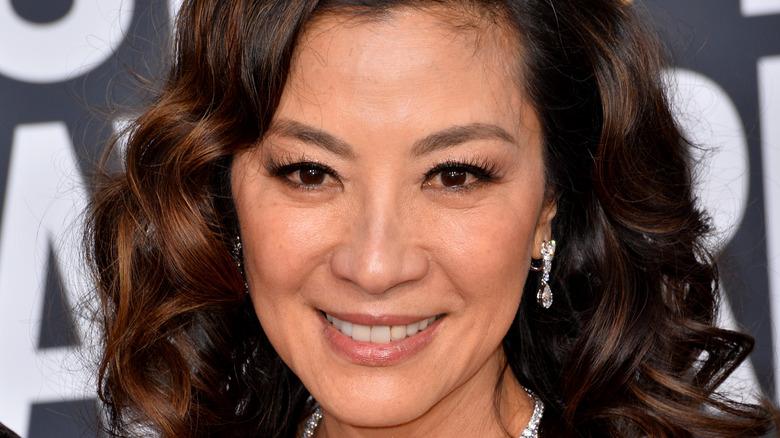 Michelle Yeoh wearing diamond earrings
