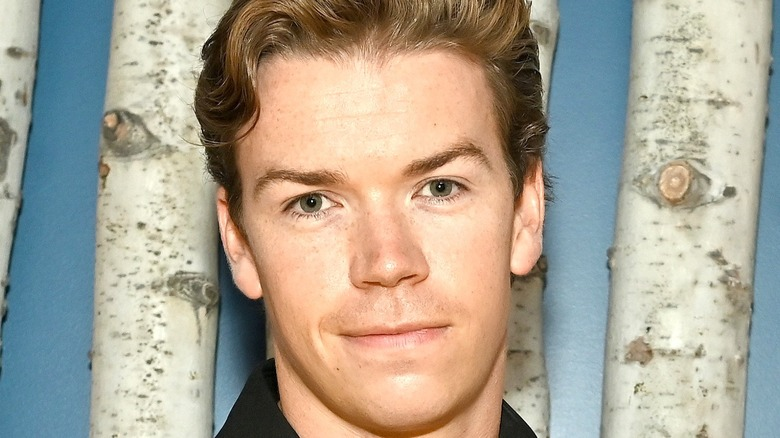 Will Poulter smiling