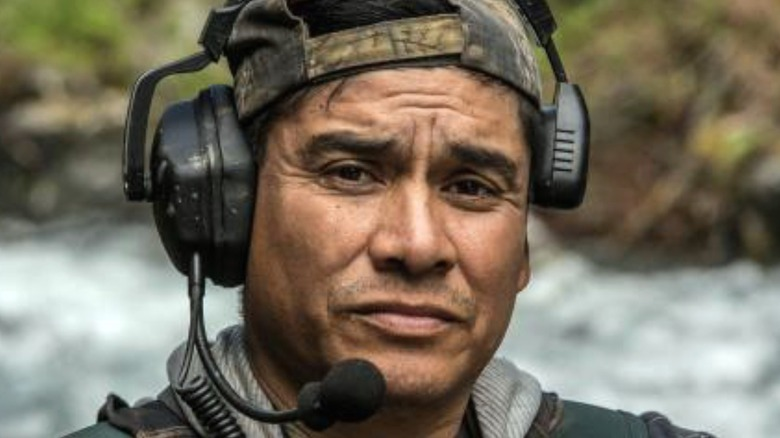Carlos Minor wearing a headset
