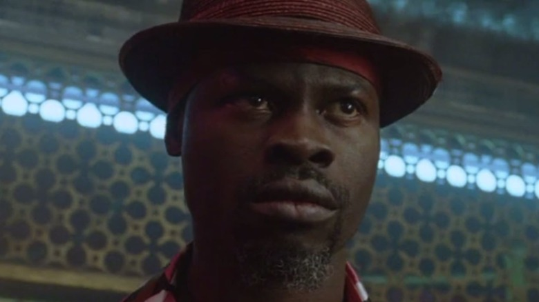 Constantine's Papa Midnite in a trilby hat