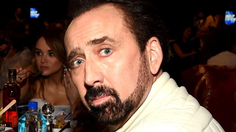 Nicolas Cage looking over his shoulder