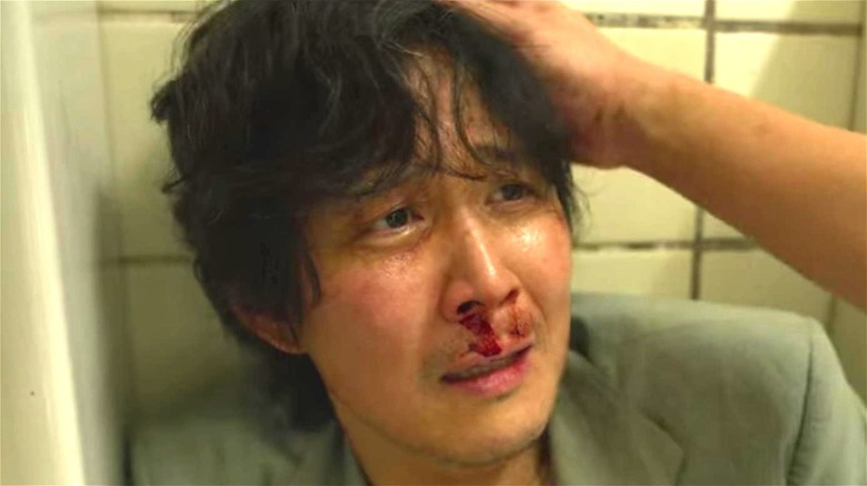 Squid Game Man Beaten Bleeding