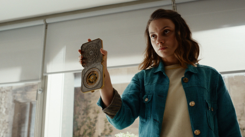 Lyra (Dafne Keen) shows off the alethiometer on His Dark Materials