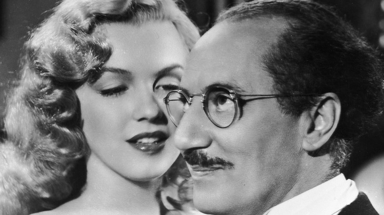 Marilyn Monroe gets close to Groucho Marx