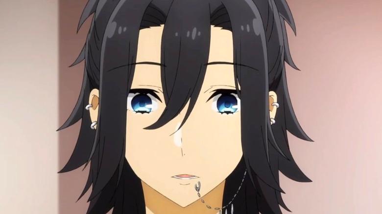 Miyamura with long hair and piercings