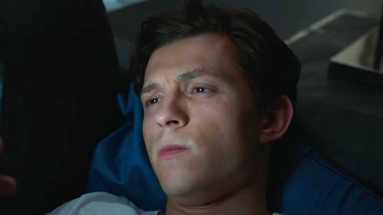 Peter Parker looking at phone
