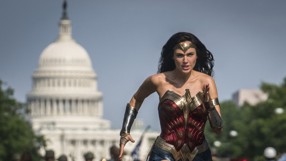 Gal Gadot running in front of the Washington DC Capitol Building in Wonder Woman 1984