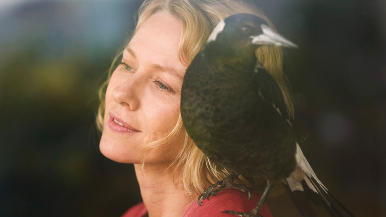 Sam Bloom with Penguin bird on her shoulder