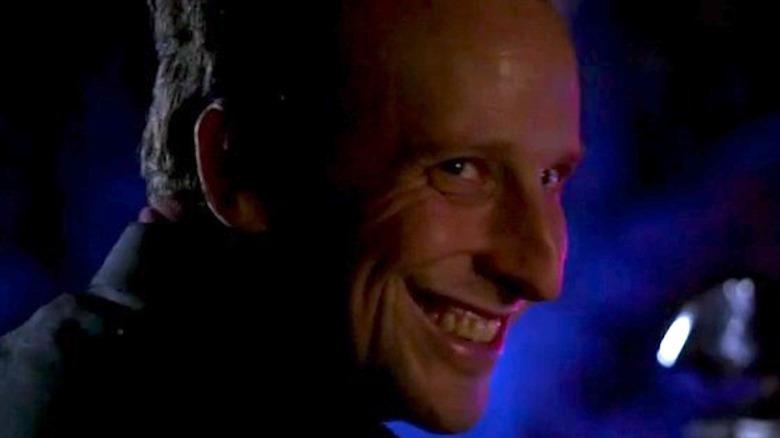 Mr. Scratch smiling in Criminal Minds