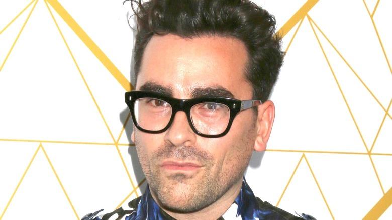 Daniel Levy glasses grinning