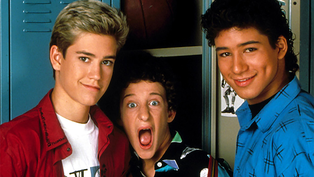 Saved by the Bell stars in front of locker