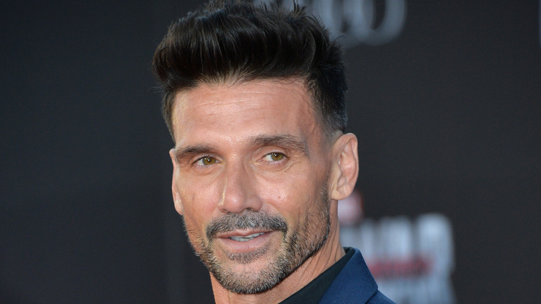 Frank Grillo wearing blue suit and black shirt