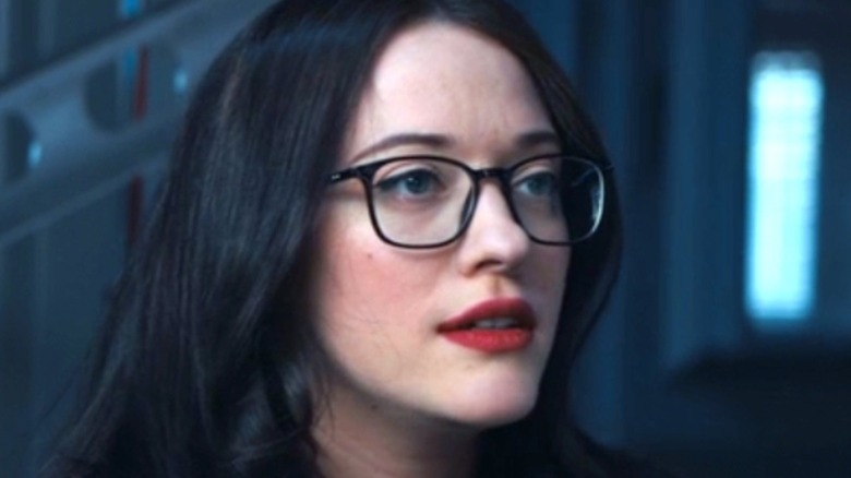 Darcy Lewis wearing glasses