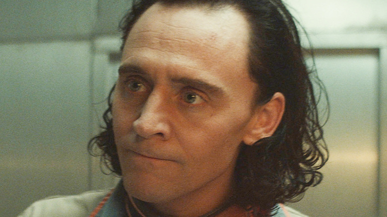Loki with his lips pressed together