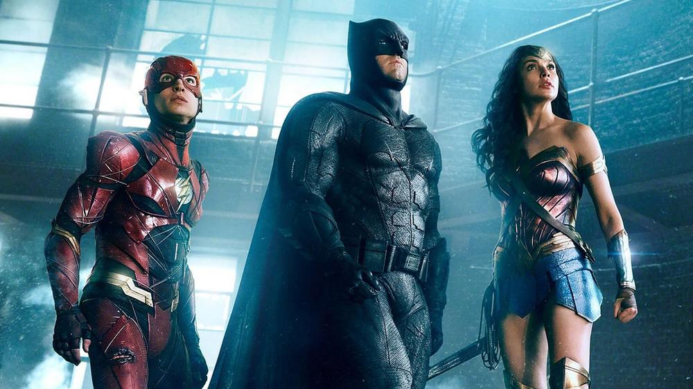 Gal Gadot, Ben Affleck, and Ezra Miller as Wonder Woman, Batman, and the Flash in Justice League