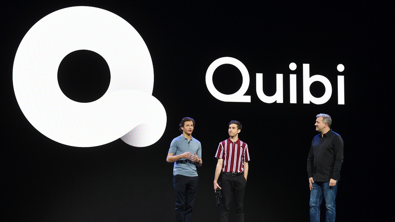 On stage with Quibi logo