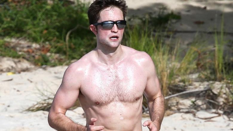 Robert Pattinson jogging on the beach