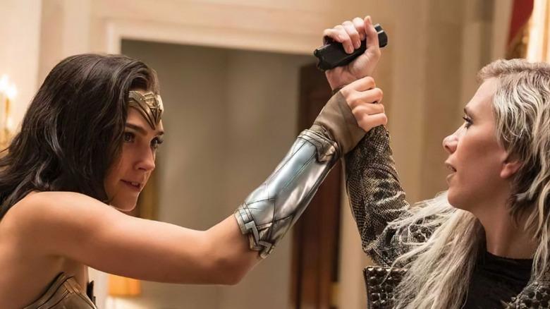 Wonder Woman grabbing Cheetah's arm