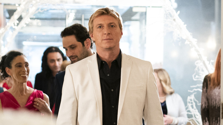 Johnny Lawrence in white suit