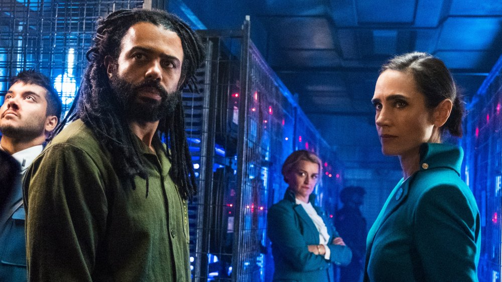 Daveed Diggs as Layton Well and Jennifer Connelly as Melanie Cavill on TNT's Snowpiercer TV series