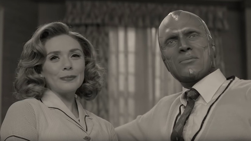 Scarlet Witch and Vision stand together in a '50s sitcom