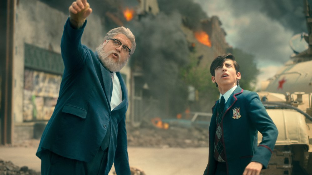 Cameron Britton and Aidan Gallagher as Hazel and Five in The Umbrella Academy