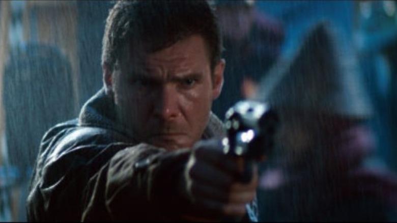 Harrison Ford as Rick Deckard firing a gun in Blade Runner