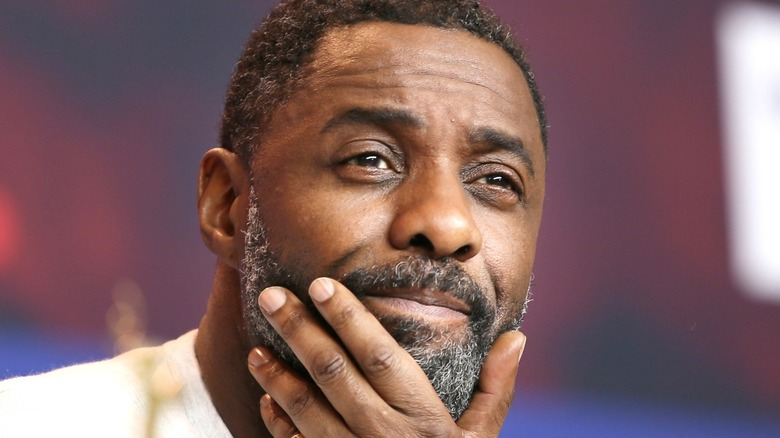 Idris Elba looking thoughtful