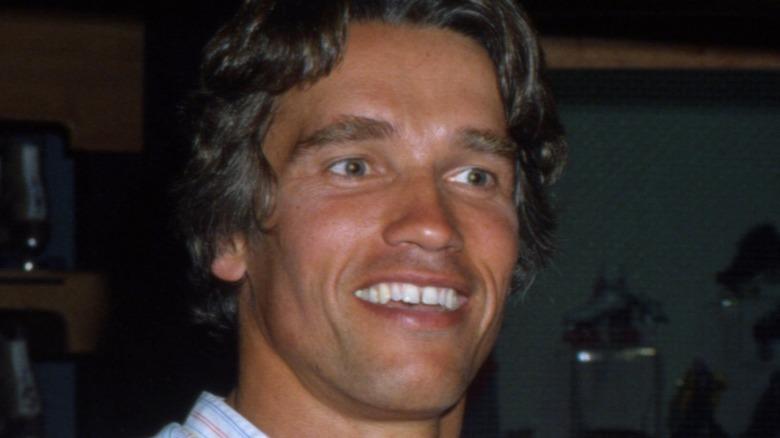Young Arnold Schwarzenegger smiling
