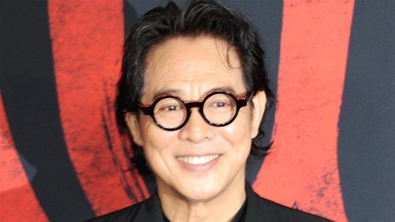 Jet Li smiling in glasses