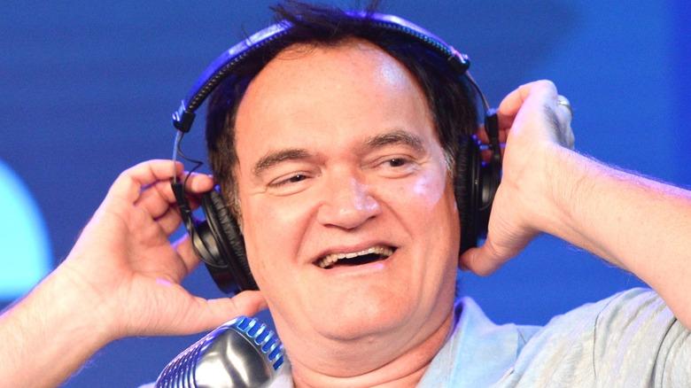 Tarantino laughing with headphones