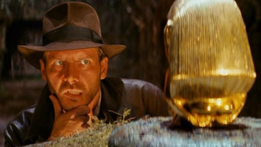 Indiana Jones eyes the golden idol in Indiana Jones and the Raiders of the Lost Ark