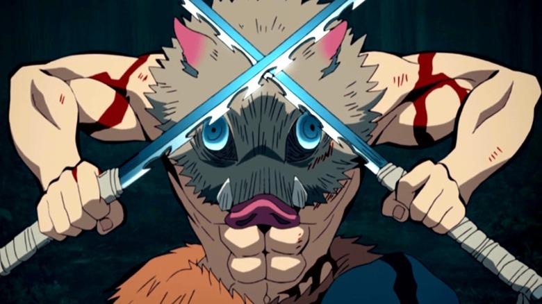 Inosuke wearing his pig mask