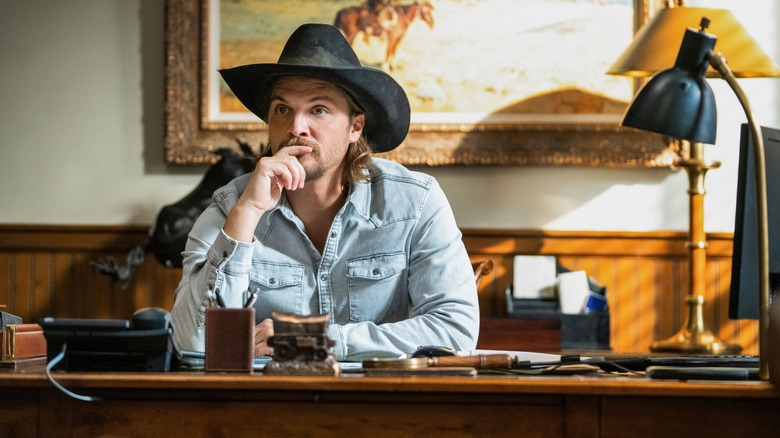 Yellowstone Luke Grimes at his desk