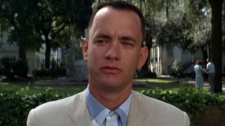 Forrest Gump in a light-colored suit