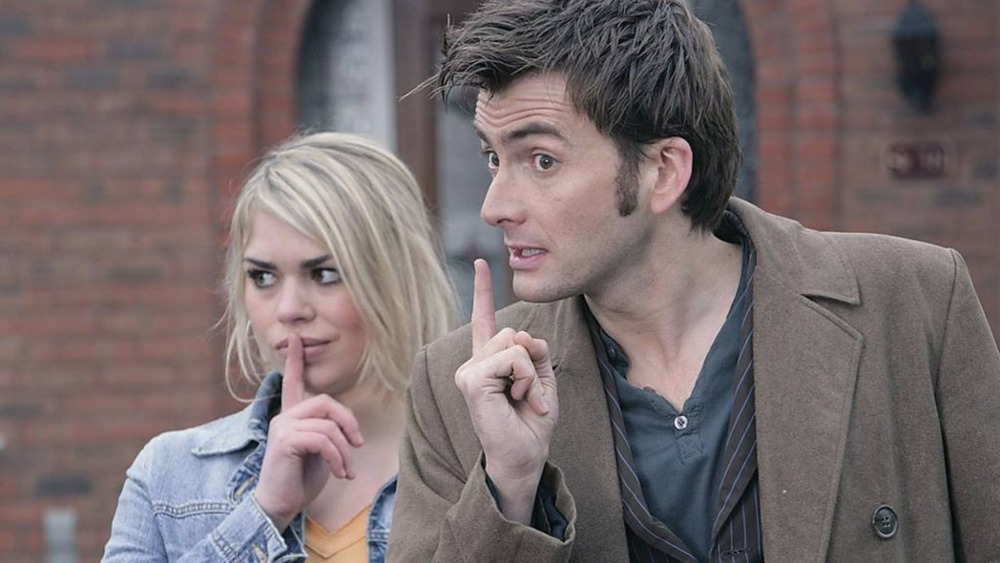 The Doctor (David Tennant) and Rose (Billie Piper) shush someone on Doctor Who