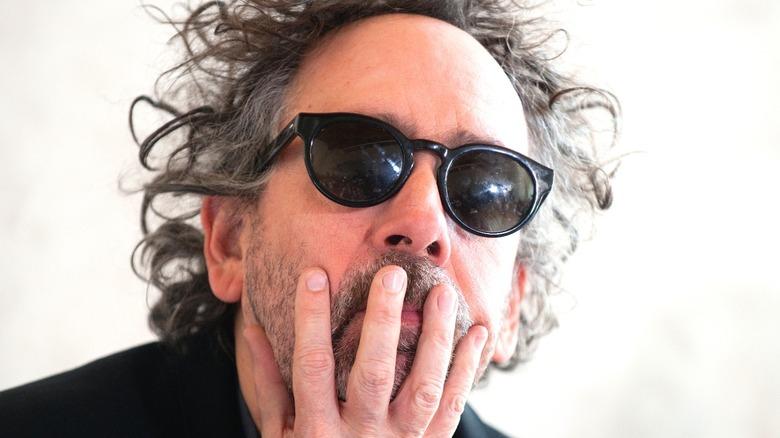 Tim Burton hand on face