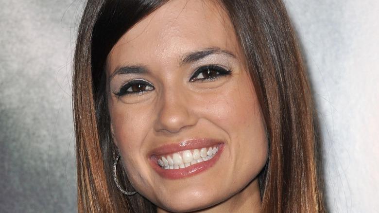 Chicago Med star Torrey DeVitto smiles