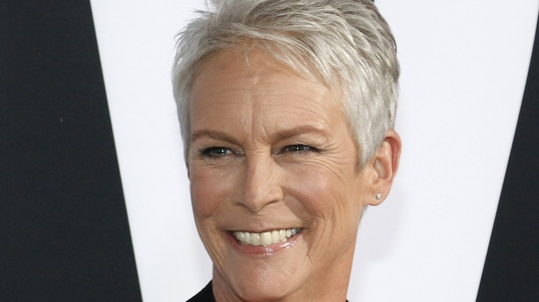Jamie Lee Curtis smiling black and white background